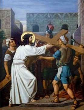 Jesus con la cruz en el calle